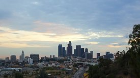 Wide Shot: Downtown L.A. Skyline Looking Southwest (Day to Night)