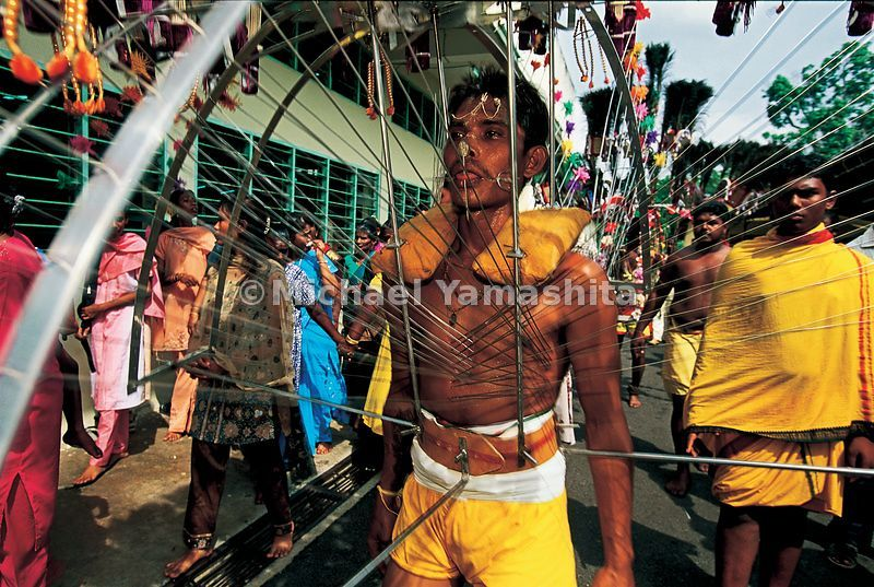 In the most extreme form of body piercing, a Malaccan kavadi bearer wears this cage of spikes and fishhooks as reparation for answered prayers.