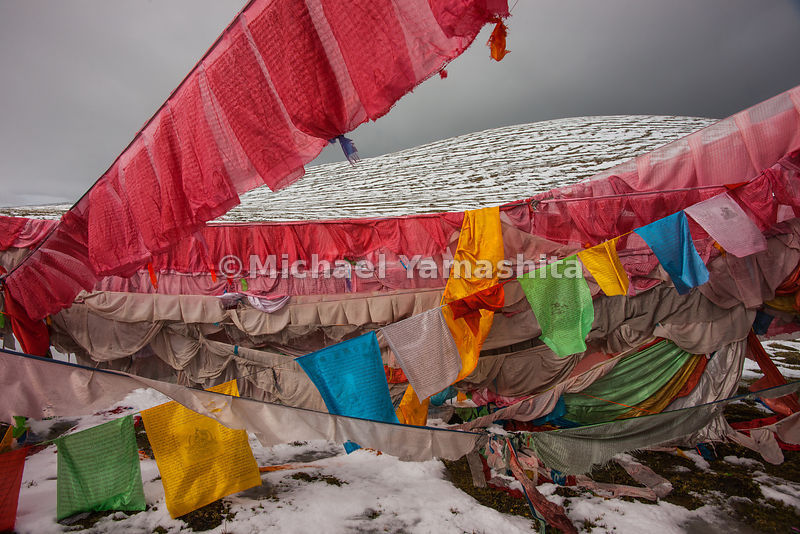 "Tibetans call these multi-colored flags ""wing horses."" They are hung to protect travelers crossing through the often-treacherous mountain passes."