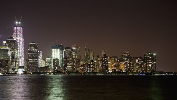Medium Shot: Lower Manhattan & An Almost Complete Freedom Tower Over The Hudson