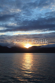 Sunset over mountains in Isfjorden, Svalbard