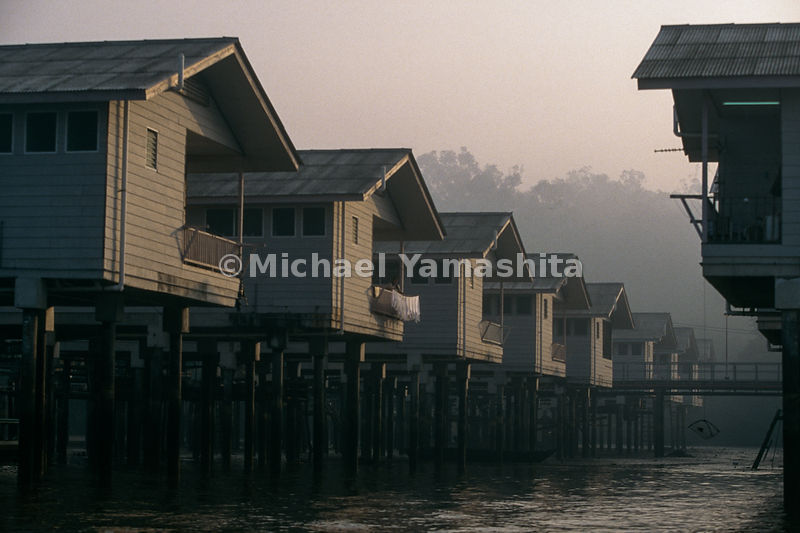"Kampong Ayer - ""Water Town"". Residents here asked to resettle in a new water village after a fire destroyed the port. Kampong Bolkiah and Kampong Poduk are newly built stilt homes that have plumbing. Residents are not allowed to paint or decorate their houses. ...Bandar Seri Begawan, Brunei"