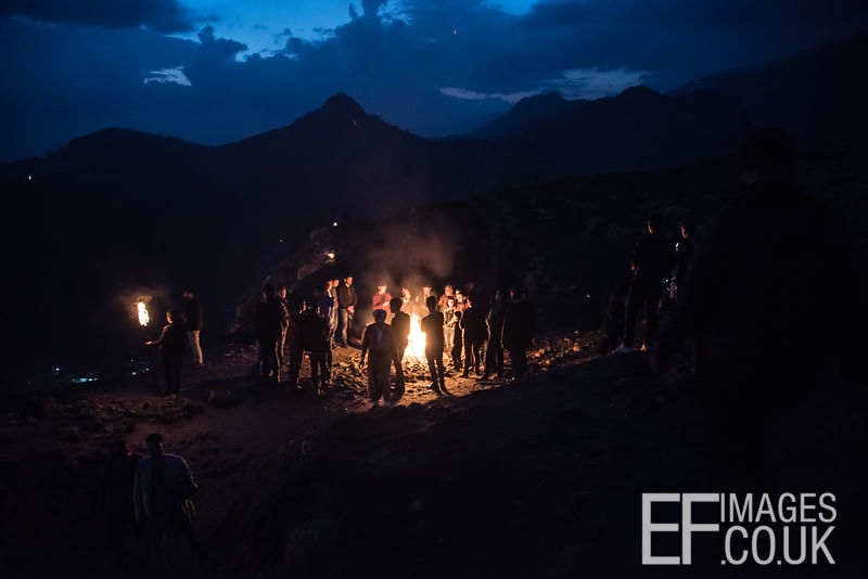 People Gathered Around A Fire For Newroz Celebrations In Akre