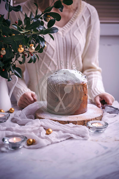 Woman with Panettone Christmas cake