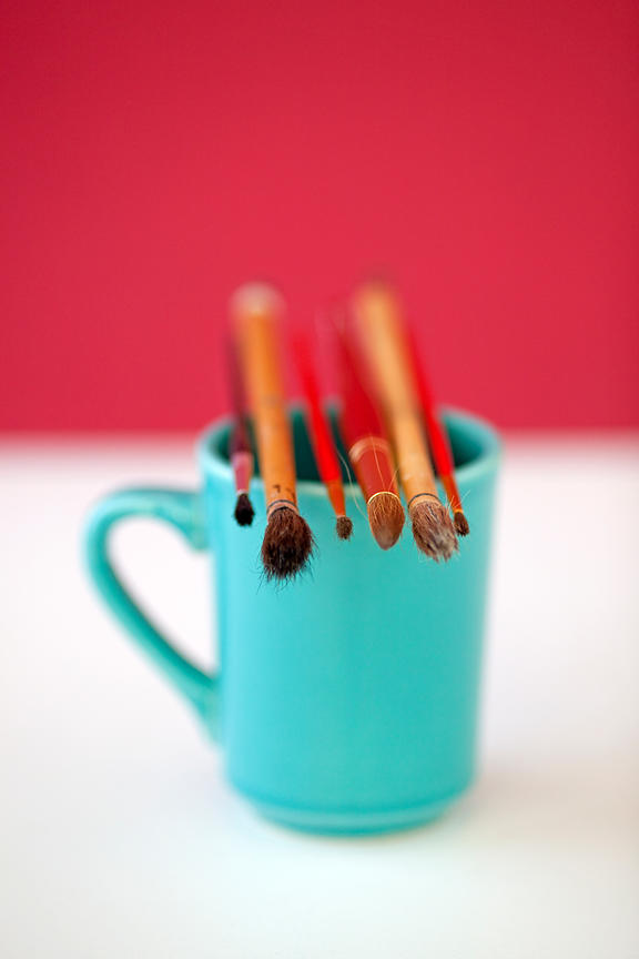 coffee cup with paint brushes