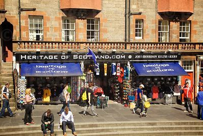 Pedestrians passing by Heritage of Scotland Tourist Gift Shop