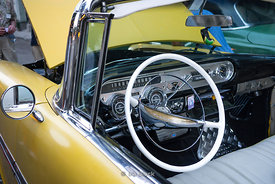 Detail of an antique yellow car in Havana, Cuba.