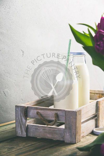 Milk bottles on wooden table. Healthy eating concept. Copy space.