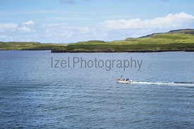 Fisherman heading out to sea near Dunvegan on the Isle of Skye, Scotland, UK.