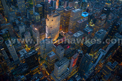 Aerial view of the skyscrapers of Midtown at night, including the Rockefeller Center complex with the GE Building in the middle
