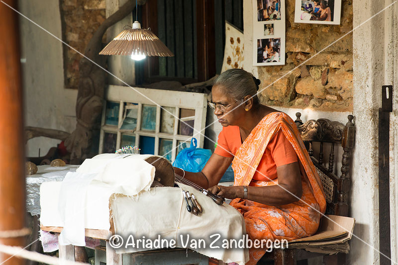 Artisan making lace using the bobbin technique, Historical Mansion museum, Galle Fort, Galle, Sri Lanka