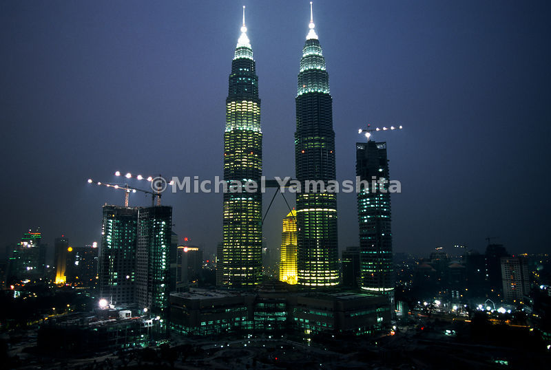 The Petrona Twin Towers are a prominent landmark during the late hours of the night.