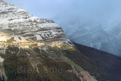 Early morning sunlight breaking through on cloudy peaks around Peyto Lake, Banff, Canadian Rockies