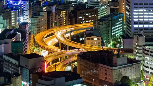 Bird's Eye: Almost Miniature - A Very Tight Shot of a Busy Tokyo Interchange Within Tight Confines of Buildings in Tokyo