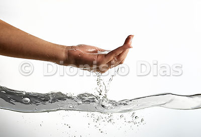 Water dripping from the palm of one hand