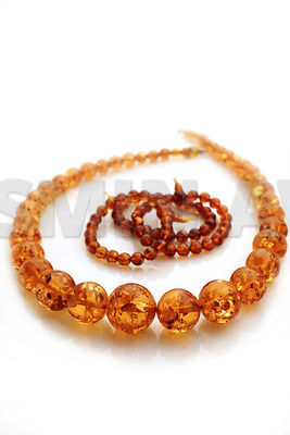 Amber Jewelry with soft reflection..Shallow DOF