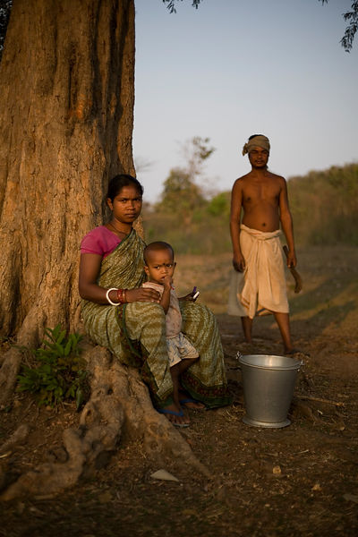 India - Orissa - A tribal woman and her husband and her child