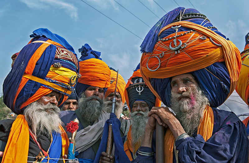 Group of Nihangs (Sikh warriors) with embellished turbans