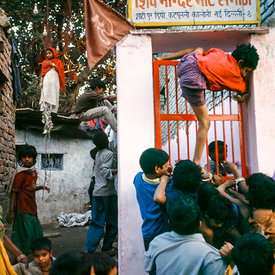 Residents scramble for free food after a temple food donation.