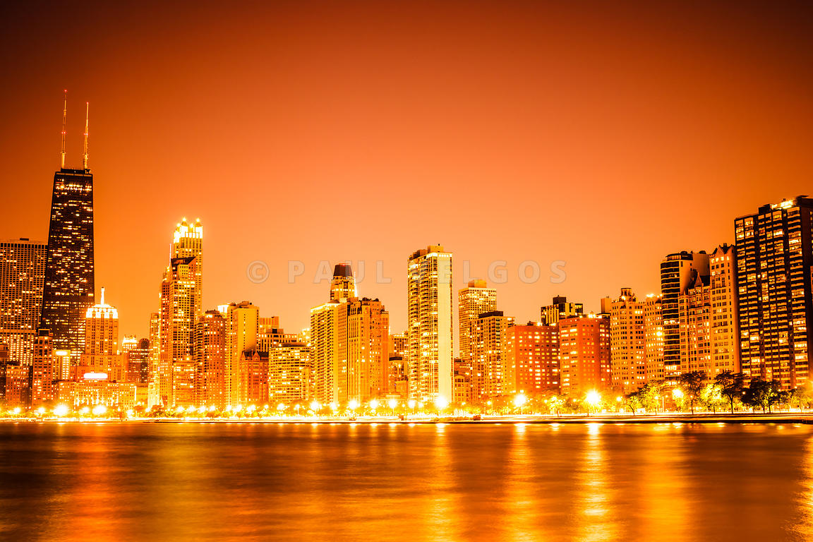 Chicago skyline at night with orange sky photo of chicago skyline at