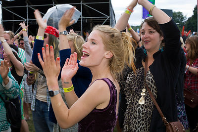 UK - Standon - Woman clap and cheer for a band playing live music at the Standon Calling Festival