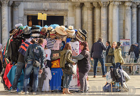 VENICE, ITALY - OCTOBER 23, 2017:  A busy market stall selling branded goods to tourists in the Piazza San Marco in Venice, Italy.