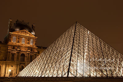 The Louvre Pyramid and Richelieu Wing of the Louvre Museum at Night - Paris, France