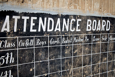 "Attendance board at an abandoned elementary school in Saboo village, Ladakh, India, with labels reading ""Boys, Girls, Bodist, and Muslim."""