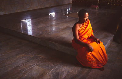 A Buddhist monk in a temple on the island of Koh Samui, Thailand