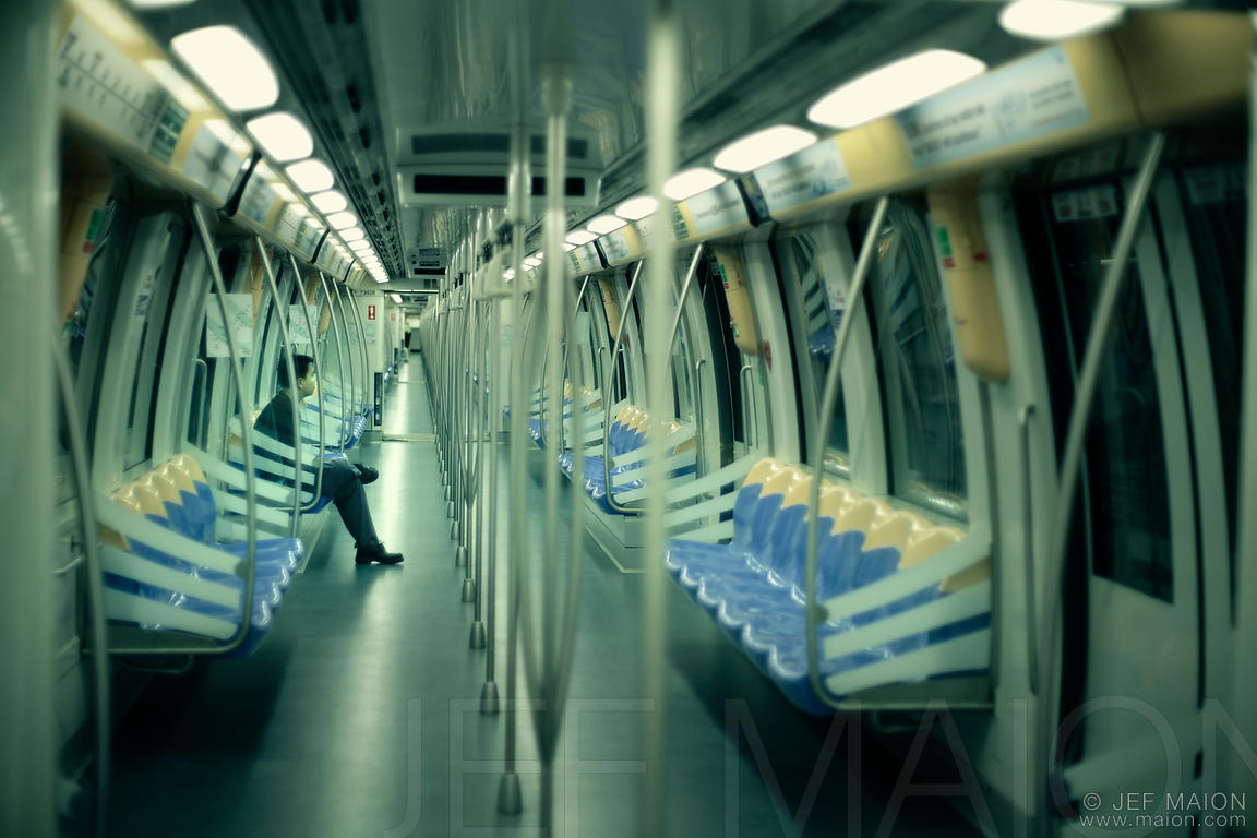 Man sitting in emtpy subway carriage