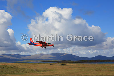 FIGAS (Falkland Islands Government Air Service) Britten-Norman Islander Aircraft VP-FBM coming in to land at Saunders Island, Falkland Islands