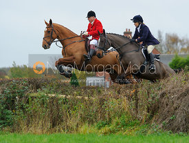James Mossman MFH jumping a hedge from the meet