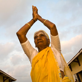 Pattu salutes the sun at dawn at the Tamaraikulum Elders village, Tamil Nadu, India