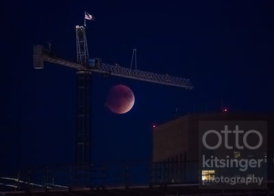 Supermoon eclipse over Boise, with the top of the US Bank building and the City Center crane, on September 27, 2015.