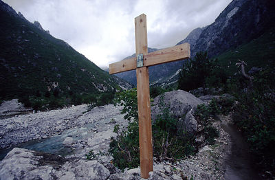 A cross with an icon stands guard over the 'Accursed Mountains' of Northern Albania
