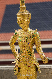 Statue at Wat Phra Kaew, Temple of the Emerald Buddha regarded as the most sacred Buddhist temple in Thailand.  It is located within the Grand Palace.