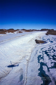 Aerial View of Ice-Cliffs and Mountains