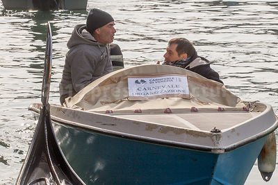 Venice Carnival Officials in boats at the Rio di Cannaregio water pageant