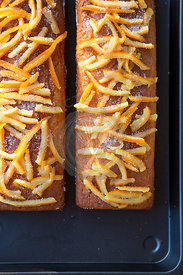 home baked orange cakes on metal tray with home made crystalised orange peel topping