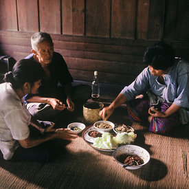Northern Thai family eating meal, village of Mae Laem, Chiang Mai.