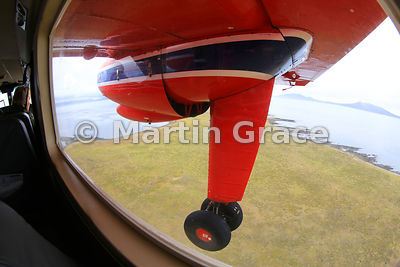 FIGAS (Falkland Islands Government Air Service) Britten-Norman Islander Aircraft over Falkland north-west outer islands
