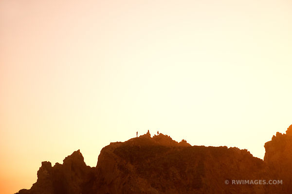 PEOPLE STANDING ON TOP OF THE ROCK AT SUNSET PFEIFFER BEACH PFEIFFER BIG SUR STATE PARK BIG SUR CALIFORNIA