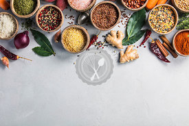 Healthy ingredients and spices on rustic murble background. Coconut shell bowls with paprika salt parsley, pepper, brown rice, couscous, red bean and lentis. Cooking concept