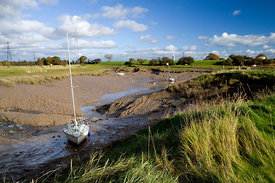 Creek at low tide and yachts Red Cliff, Severn Estuary near Chepstow, Wales.