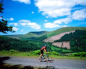 cyclist on taff trail torpanau with waun rydd in distance brecon beacons national park wales
