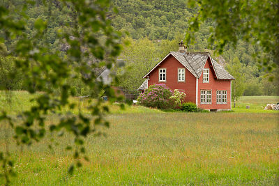 Small Red Norwegian House in a Field
