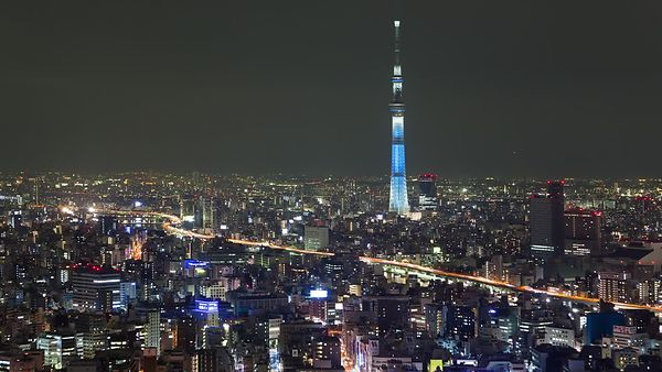 Bird's Eye: Tokyo's Skytree Dwarfing Mid-Rises & A Busy Highway At Night