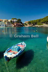 boat appearing to float in air, assos harbour, kefalonia, ionian islands, greece
