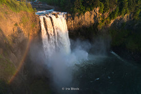 A rainbow forms over the Snoqualmie Falls in Snoqualmie Falls park in Cascade Mountains near Seattle, Washington.