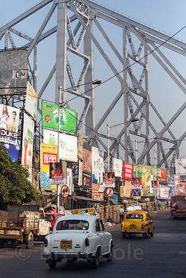 Howrah Bridge is a focal point in Kolkata, India. It carries people, bikes, carts, trucks, cars, and animals over the Hooghly River, and is one of the busiest bridges in the world.